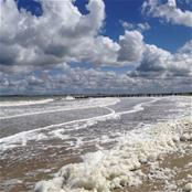 Fluffy clouds and beach